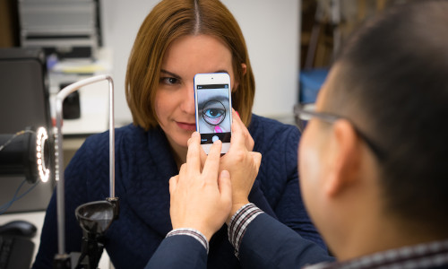 A Purdue University researcher using a smartphone app that can accurately extract information about a person's blood hemoglobin content from a photo of the inner eyelid.